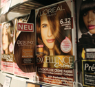 The flaps highlight the L'Oréal and Garnier packs on the shelf.